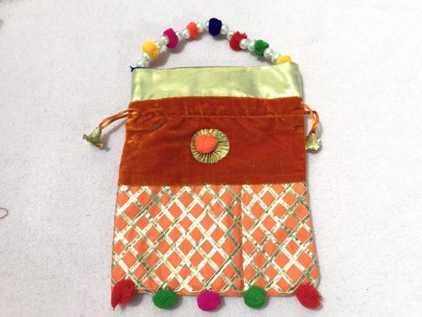 Orange Velvet Potli Bag with Moti Handle 1